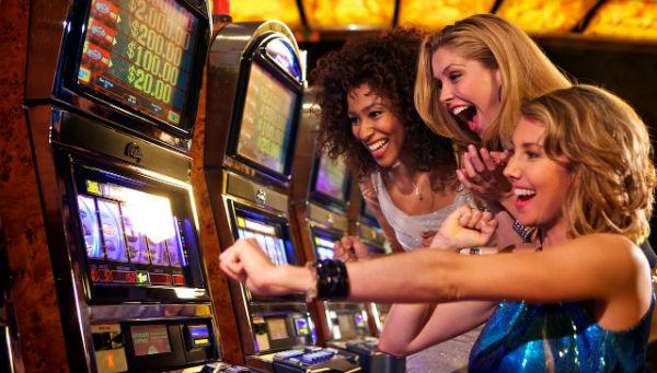 Girls playing Video Poker